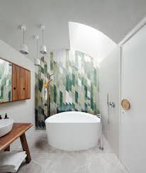 25 creative geometric tile ideas that bring excitement to your home snazzy green tiles used to create an awesome feature wall in the bathroom design