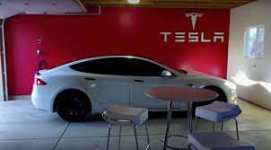 model s owner transforms home garage into a tesla gallery showroom