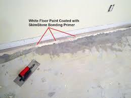 finishing a basement bedroom concrete floor with skimstone