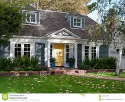 house with yellow door with witch for halloween stock photo