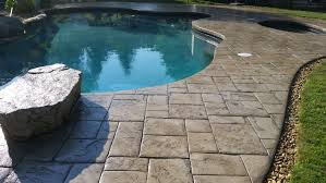 stamped concrete pool deck sealed with the foundation armor ar350