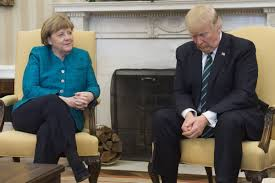 trump oval office pictures trump doesn u0027t shake hands with merkel during photo op new york post