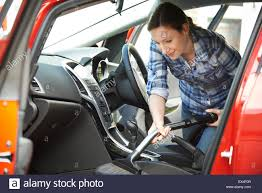 Car Cleaner Interior Woman Cleaning Interior Of Car Using Vacuum Cleaner Stock Photo