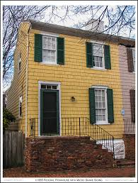 a c1885 federal style rowhouse with chesapeake yellow wood shake