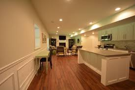 floor basement flooring with dark wooden flooring and white wood