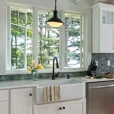 kitchen windows over sink kitchen windows farmhouse sconce style lights above kitchen windows