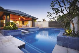 comfy modern house with small backyard with pool and chaise longue
