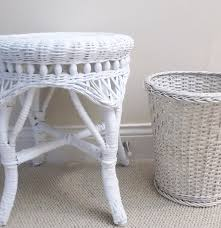 white wicker side table and waste basket ebth