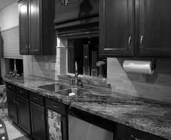 what color kitchen cabinets go with black appliances 59 cu ft traditional black and white kitchen design ideas with dark wooden cabinetry also granite top kitchen