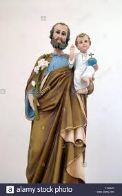 saint joseph holding baby jesus statue in the church of saint