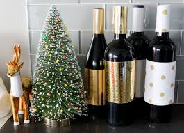 christmas decorating hack cover wine bottles with metallic craft