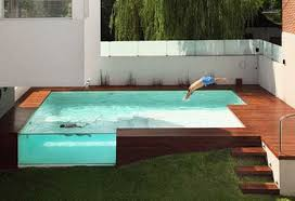 Patio That Turns Into Pool Decked Out Wood Patio Above Ground Swimming Pool
