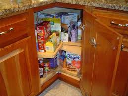 corner lazy susan cabinet installed in the kitchen with granite