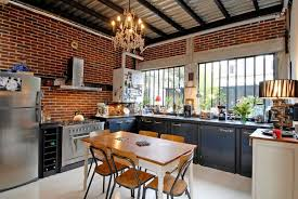 exposed brick wall lighting black white cabinets exposed brick walls small wooden island with