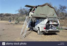 jeep roof top tent off road jeep car with the tent on top of the roof stock photo
