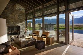 montana ranch house embraces its striking river valley location