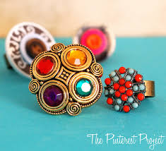 gaudy earrings button statement rings the project