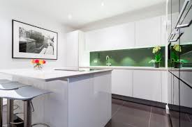 high gloss kitchen with white lacquer kitchen island and seating