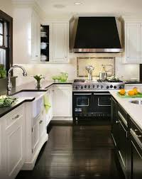 white kitchen with black island white cabinets black counter black island white counter