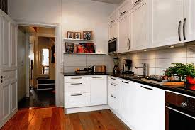 decorating a small kitchen apartment sleek white wooden cabinet