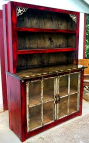 distressed buffet hutch w iron accents and antique windows