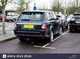 land rover car range rover car parked in a disabled parking space stock photo