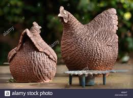 a pair of ornamental chickens in a garden uk stock photo royalty