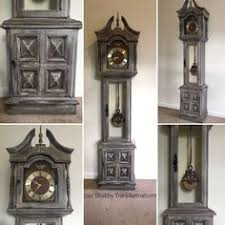 grandfather clock re purposed into a wine rack made by pickin