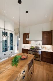 mixing kitchen cabinet wood colors your kitchen mix wood and painted finishes