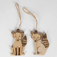 pair of wooden fox hanging tree ornaments