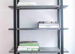 how to style a bookshelf with homepolishs orlando soria bookcase