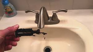 bathroom sink quick fix how to remove and clean the stopper
