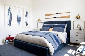 blue and gray boy room with blue surfboard art transitional