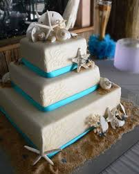 beachy wedding cakes the blue ribbon around the bottom of each tier brings a
