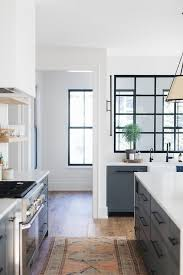 navy blue kitchen cabinets with black handles blue shaker cabinets with farmhouse sink transitional