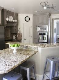 what color to paint cabinets with granite choosing my battles and a paint color shanty 2 chic