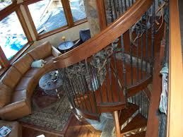 hand made melting iron u0026 wood into a spiral staircase by cabinets