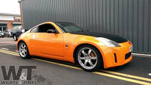 nissan orange nissan 350z full gloss orange wrap with gloss black features