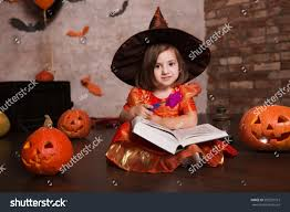 happy halloween cute cheerful little witch stock photo 502537513