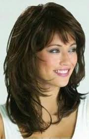 medium length tapered or layered hairstyles for women over 50 layered cut with bangs hairstyles for round faces bangs
