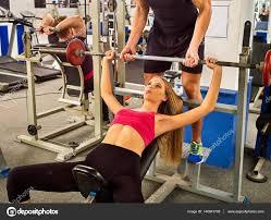 fitness friends workout gym woman working on bench press u2014 stock