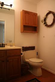 half bathroom decorating ideas with peach wall color and wooden