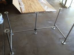 diy pipe desk plans building desk from pipe using a can of white primer spray paint