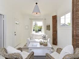 make a small cottage space feel more roomy with all white