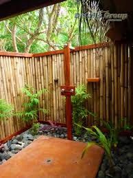 exterior bamboo fencing and wooden pillars for contemporary