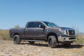 nissan titan xd lifted daystar driven by design