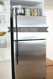 top of fridge storage how to decorate organize the top of your fridge fridge decor