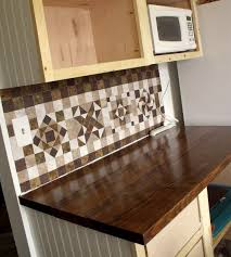 easy cheap diy backsplash self adhesive vinyl floor tiles made