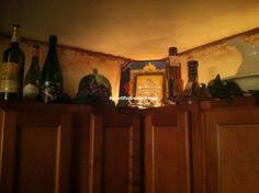 Top Of Kitchen Cabinet Decor by Tuscan Decor Inspirations Decorating Kitchens And Tuscan Style