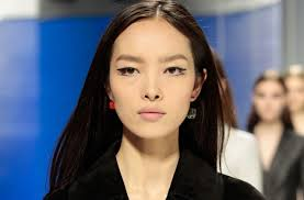 mismatched earrings trend mismatched earring trend resort 2014 runway